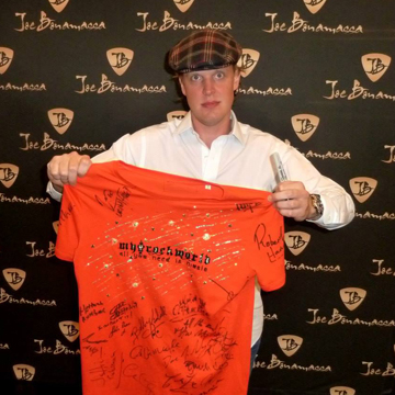 myRockworld memorabilia: Joe Bonamassa with The myRockworld UNIKAT Special BLING T- Shirt, front signed by Herman Rarebell (Scorpions), John Parr, Bobby Kimball (Toto), Jon Hiseman, Dave Greenslade, Clem Clempson, Barbara Thompson, Chris Farlowe (Colosseum), Al Di Meola, etc.